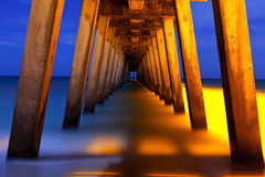 Underside of pier at night. Long time exposure Stock Images