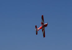 Underside of red Model Airplane Flying Royalty Free Stock Photo