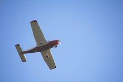 Underside of Single Engine Plane in Flight Stock Photo