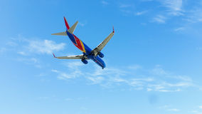 Underside of Southwest Airlines jet in air Royalty Free Stock Photos