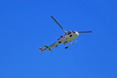 Underside of utility helicopter with lifting cable Royalty Free Stock Photo