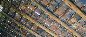 Underside of very old multi colored Tiled Roof royalty free stock image