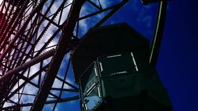 Underside view of a ferris wheel over blue sky stock footage