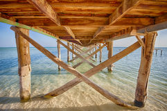 Underside of a wooden jetty in tropical sea Royalty Free Stock Photography