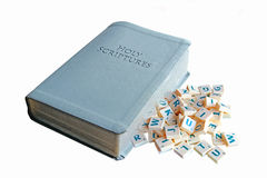 Understanding the bible. Concept photo of scrabble letter tiles on open bible depicting understanding the bible Royalty Free Stock Images