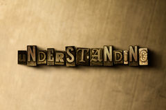 UNDERSTANDING - close-up of grungy vintage typeset word on metal backdrop Royalty Free Stock Photography