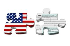 Understanding how to do your taxes. Two puzzle pieces with the flag of the USA and a US Federal tax 1040 income tax form over white Royalty Free Stock Photo