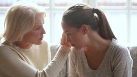 Understanding old mother worried about upset young daughter having problem. Understanding loving senior mother worried about upset young daughter having problem stock video