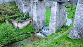 Undert he bridges of the corving castle in transylvania. In the spring alongise a creek royalty free stock images