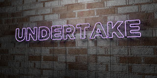 UNDERTAKE - Glowing Neon Sign on stonework wall - 3D rendered royalty free stock illustration Stock Images