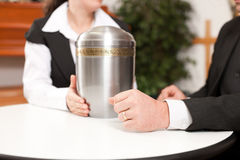 Undertaker is advising a client for the funeral. Mortician with client comforting and advising Stock Photography