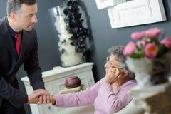 Undertaker comforting elderly woman. Undertaker comforting elderly women funeral Royalty Free Stock Image
