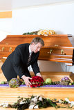 Undertaker in his store. With a display of coffins Stock Photo