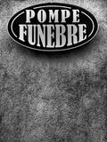 Undertaker sign. In Romanian `Pompe Funebre` on a street in Brasov, Romania. Black and white filter applied Royalty Free Stock Photos