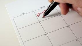 Underteckna dagen i kalendern med en penna, dra en bra dålig dag