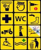 Underteckna med 12 instuctionalsymboler för offentlig strand Arkivbilder
