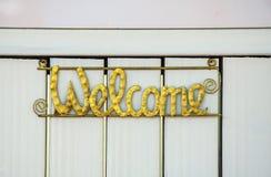 underteckna välkomnandet Fotografering för Bildbyråer
