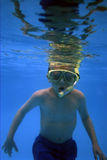 Underwater #1. Young boy snorkeling in a motel pool stock photography
