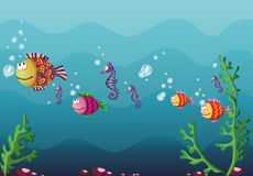 Underwater. Colorful fish and air bubbles floating in a blue water background Royalty Free Stock Image