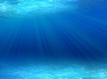 Underwater. Blue background of underwater ray of lights Stock Images