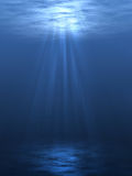 Underwater. An underwater scene with sunrays shining through the water's glittering and moving surface Royalty Free Stock Images