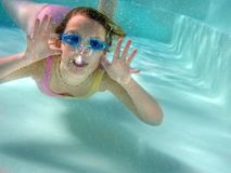 Underwater aerobics. Swimming in a pool 8 y.o. happy girl Stock Photo