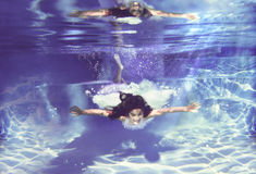 Underwater angel. Girl with wings seems to be flying underwater Stock Photo