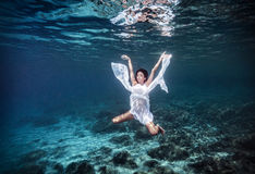 Underwater angel Stock Image