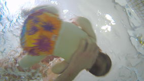Underwater: baby swimming in the child pool stock video