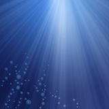Underwater background. With bubbles and sun rays royalty free illustration