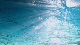 Underwater background,Rays of light make their way through ocean waves from looping animation High quality Light rays. High quality Looping animation of ocean stock video