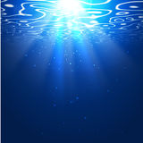 Underwater background with sun rays. Editable vector background Stock Images