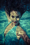 Underwater, beauty concept, beautiful brunette woman with smooth Royalty Free Stock Photo