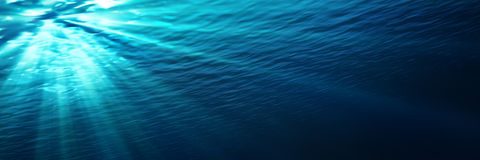 Underwater - blue shining in deep of the sea Royalty Free Stock Photo