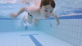 Underwater boy in aquapark stock video footage