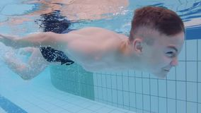 Underwater boy in aquapark stock footage