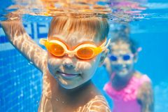 Underwater boy. Close-up underwater portrait of the cute smiling boy Royalty Free Stock Images