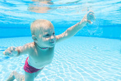 Underwater boy with an empty bottle Royalty Free Stock Images