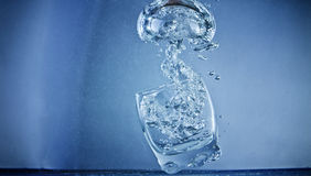 Underwater Bubble from Glass. High speed shot of a shot glass underwater - Mushroom bubble rising Stock Photography