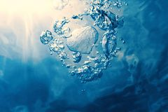 Underwater bubbles with sunlight. Underwater background bubbles. Nature Background royalty free stock photo