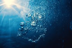 Underwater bubbles with sunlight. Underwater background bubbles. Nature Background royalty free stock photography