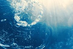 Underwater bubbles with sunlight. Underwater background bubbles. Underwater royalty free stock photo