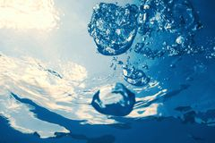 Underwater bubbles with sunlight. Underwater background bubbles. Underwater royalty free stock photography