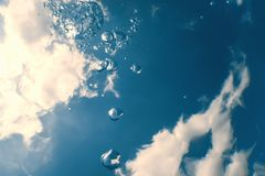 Underwater bubbles with sunlight. Underwater background bubbles. Underwater royalty free stock images