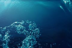 Underwater bubbles with sunlight. Underwater background bubbles. Underwater royalty free stock image