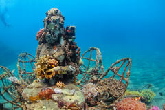 Underwater Buddha statue with diving snorkeler on the background Stock Photos