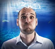 Underwater businessman Stock Images