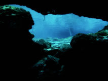 Underwater cave exploration. Looking onto open waters from an underwater cave or cavern at Ginnie Springs in Gilchrist County, Florida (USA Royalty Free Stock Images