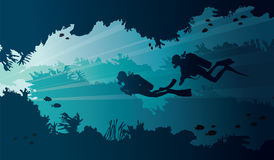 Underwater cave and scuba divers on a sea. royalty free illustration