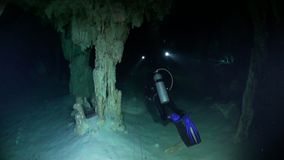 Underwater caves in Yucatan. Scuba diving in Mexico. Rocks and stones of cenotes in pure water stock footage